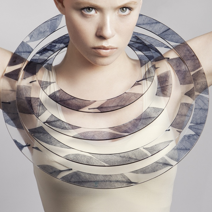 Sculptural plastic ring neckpiece blending manmade materials with the natural world; organic-inspired jewellery design // Sue Gregor