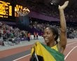 Shelly-Ann Fraser-Pryce celebrates winning gold in the women's 100-metre final.