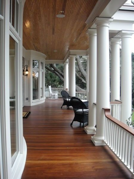 Love wrap around porches and this wooden floor is wonderful!