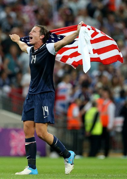 Abby Wambach #14 of the United States celebrates after defeating Japan by a score of 2-1 to win the Women's Football gold medal match on Day 13 of the London 2012 Olympic Games at Wembley Stadium on August 9, 2012 in London, England.
