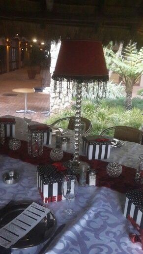 Red, black, white & crystal dinner table. 70th birthday dinner.