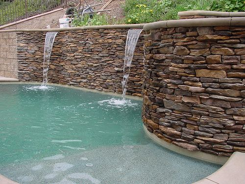 Best 25 pool retaining wall ideas on pinterest backyard for Pool design for sloped yard