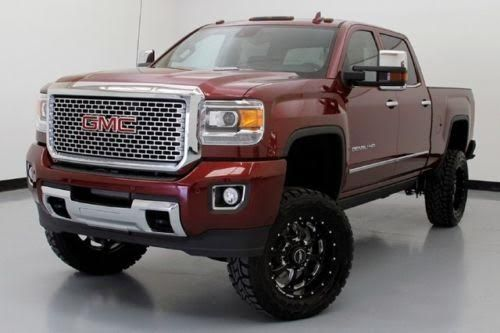 "2015 GMC Sierra 2500HD Denali Custom 4X4, Duramax 6.6L Turbo Diesel V8 Engine, Allison 1000 6-Speed Auto,Only 321 Miles, Asking $79,991.00, Sonoma Red Metallic/Jet Blk Leather Bucket Seats,6"" Pro Comp Suspension Lift Kit, 20"" BMF Wheels, 35""Toyo Open Cntry RT Tires, Navigation, Moonroof, AMP Powered Retracting Running Boards, Duramax Plus Package, Driver Alert Package w/Vibrating Driver Seat Alerts,Front/Rear Parking Sensors, Bose Audio System, Power Front Seats,Heated/Cooled Front…"