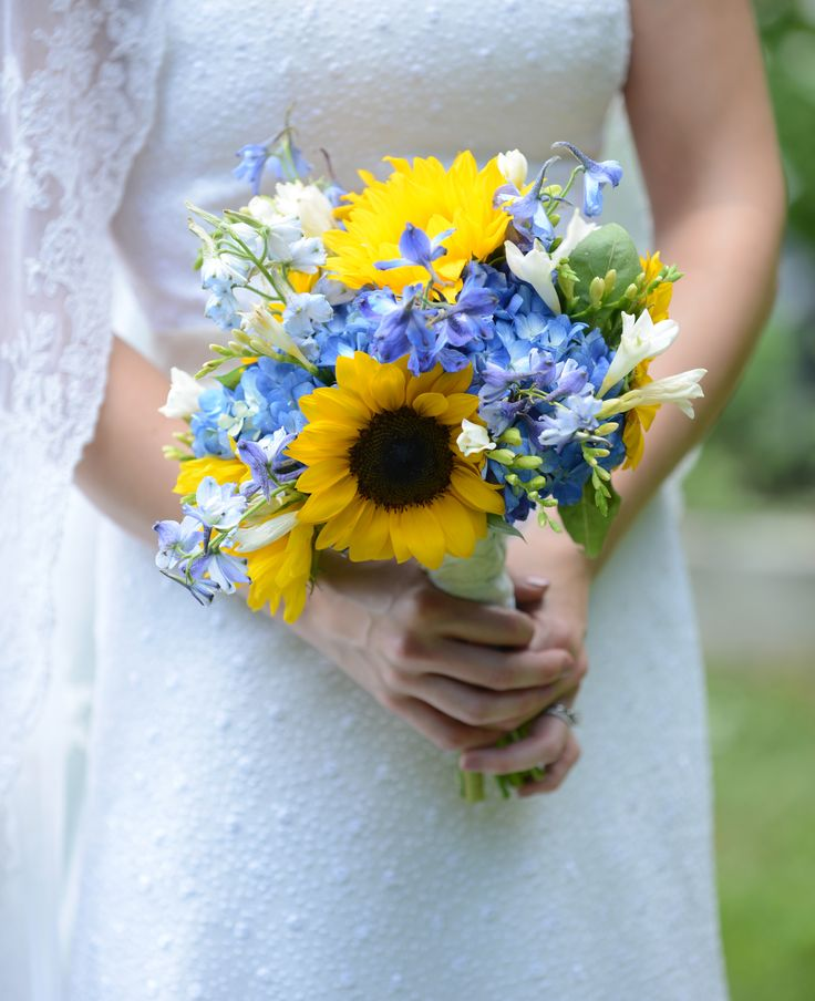 Summery Sunflower and Blue Delphinium Bridal Bouquet by Artfully Arranged