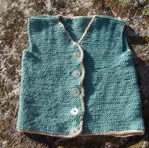 This vest is knitted Tussah silk/wool garn.It is petrol blue in color.Ever so soft and light.Will fit for a boy about 3years of age.Handwash only.