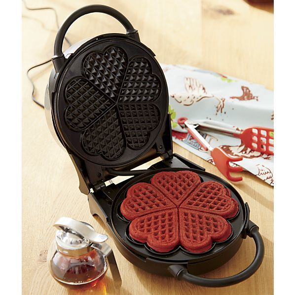 Add some extra love to home-cooked breakfasts and Sunday suppers. With 1,000 watts of power and a whopping six browning settings for your ideal crispness level, this waffle maker features nonstick griddle plates that cook up one big shamrock-shaped waffle or five separate heart-shaped waffles. Waffle maker stands upright for optimal storage.