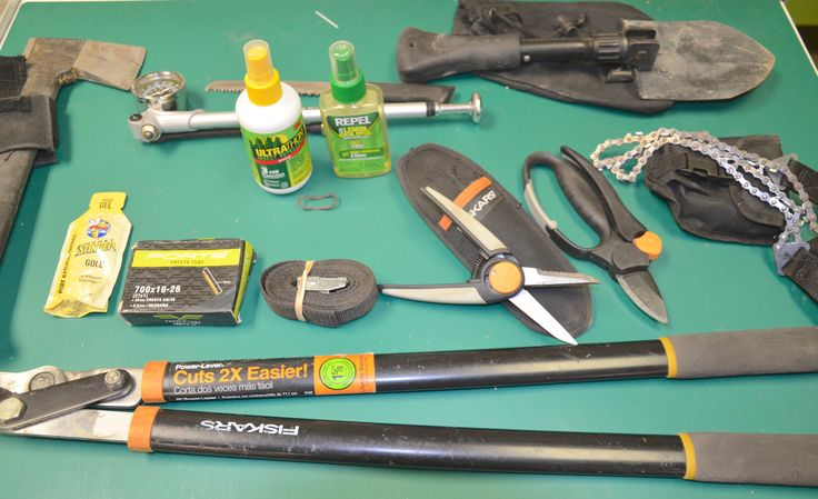 The Ultimate Trail Building Kit (carried in hydration pack): Hatchet, pump, shovel, chain saw, shears, pruners, strap, tube, food, bug spray, branch cutter