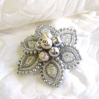French beaded flower as brooch. I like the use of larger beads, framing each petal.