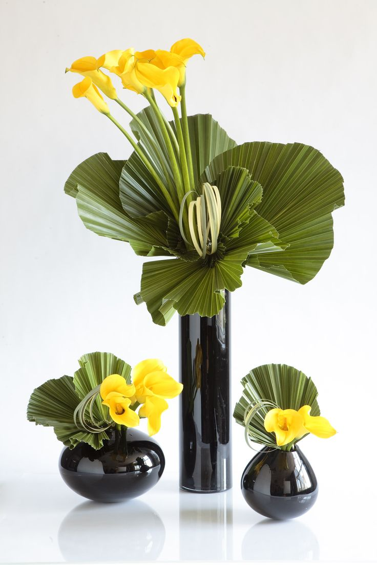 Modern yellow arrangements.  Remember those black vases I showed you? @Lauren Davison Davison Davison Davison Jackson
