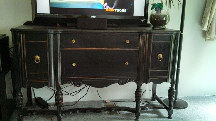 Refurbished antique buffet used as a tv stand! Did it myself and it turned out great!! Love the