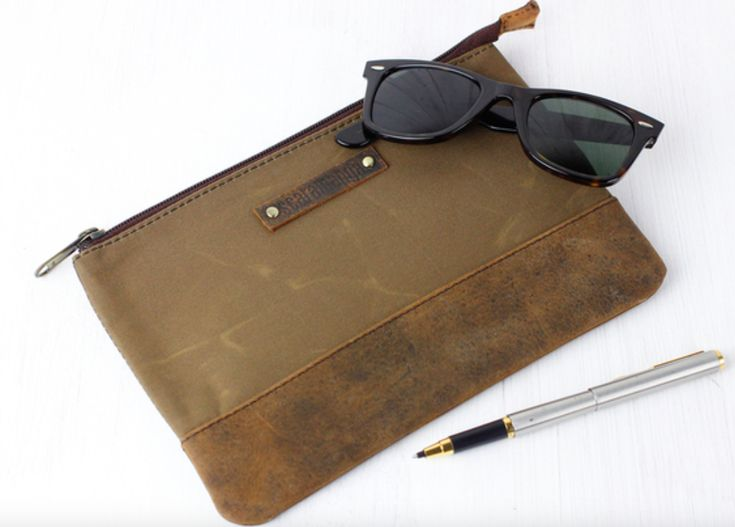 The canvas & leather pouch has been designed to act as a multi-purpose pouch for men and women. #vintage #canvas #accessories