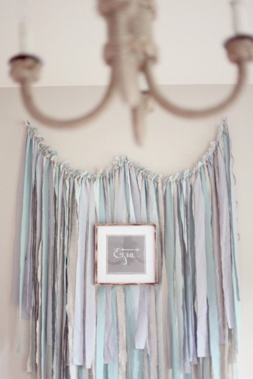 The ribbon display was made by my best friend for my baby shower. As soon as I saw it at the party, I knew I would incorporate it into my baby's room. It is such a meaningful and beautifully designed backdrop.