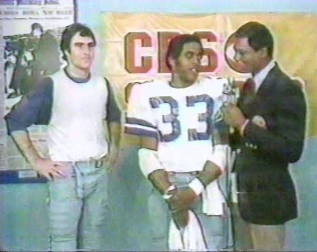 The NFL Today's Irv Cross interviews running back TONY DORSETT (33) and quarterback DANNY WHITE (11) following the Cowboys' win over the LA Rams in the Wild Card playoffs on December 28, 1980