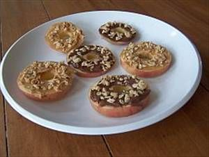 Apple Snackers - A high protein kid favorite that will keep them satisfied between meals. Ingredients 1 tbsp chopped walnuts 1 tbsp peanut butter 1 medium apple Directions Slice apple in half and remove core. Spread out nuts on a small plate. Spread cut side with peanut butter and press into nuts. Enjoy or wrap and save for later. Great for lunches.