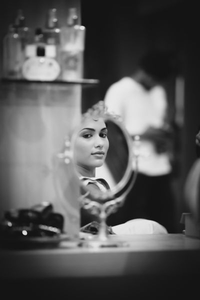 bride looking in mirror, black and white bridal portraits