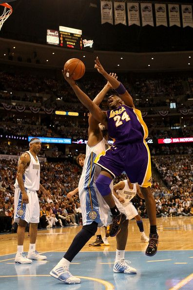 Kobe Bryant #24 of the Los Angeles Lakers goes up for a shot in the lane over Nene #31 of the Denver Nuggets in the first quarter of Game Four of the Western Conference Finals during the 2009 NBA Playoffs at Pepsi Center on May 25, 2009 in Denver