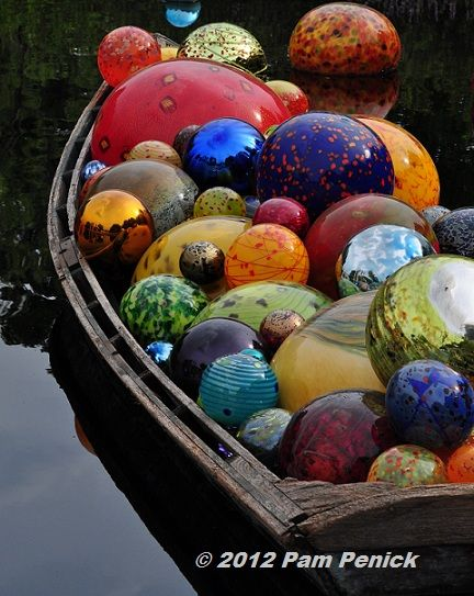 Boat full of gazing balls - would be so cool out in my pond.