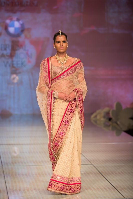 Tarun Tahiliani Indian bridal sari. More here: http://www.indianweddingsite.com/bmw-india-bridal-fashion-week-ibfw-2014-tarun-tahiliani-show/
