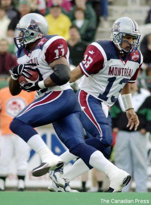 Qb Anthony Calvillo hands off to Lawrence Phillips - 2002
