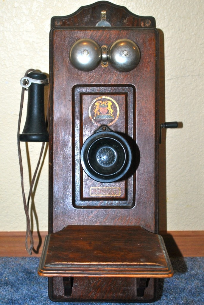 """Antique phone...we had a phone like this in the home we moved into in 1949...and it was a """"party line""""  you spoke to an operator after turning the crank....each home was assigned a certain number of rings, so say if it rang three times, you could answer...if it rang four times, it was for your neighbor....you always had to count the rings!"""
