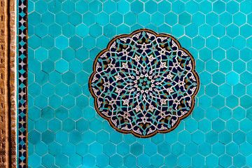 Blue arabesque Islamic geometric patterns inside an old mosque in Yazd, Iran