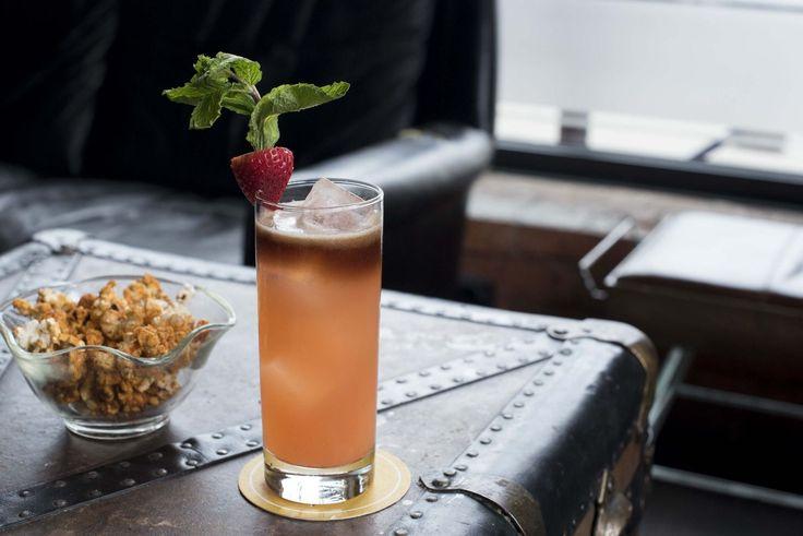 High Color Buck 1.5 oz rum  .5 oz Cruzan Black Strap Rum (float)  .5 oz ginger  .75 oz lime juice  1 whole strawberry (Muddled)  Garnish: whole strawberry and a mint sprig