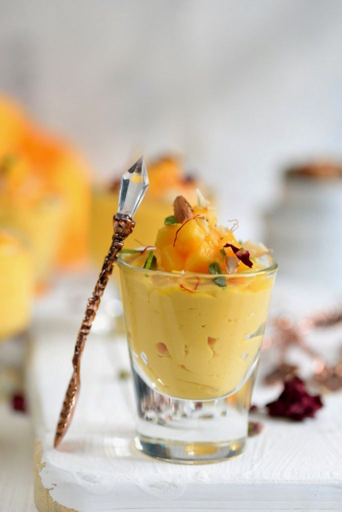 #Mango #MangoRecipes #Mangolicious  Thinking about an ideal dessert/ side dish for this Summer? What can be better than chilled, soft Kesar Aam Srikhand? Read its recipe and make sure to try it this Summer with piping hot Poories: