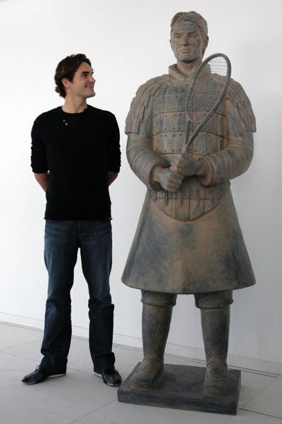 Top tennis player Roger Federer with his Tennis Terracotta Warrior sculpture in Madrid (October 2007)
