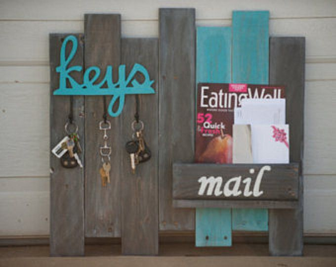 Keep your mail organized and keys organized with this hanging Key and Mail Organizer. This is a wood key/mail organizer that was built out of reclaimed wood. Features gray and turquoise stain on reclaimed, distressed wood, and has three hanging hooks for keys and a box for mail.  Dimensions for the Key and Mail Organizer features a length of 24 inches, height of 23 3/4 inches, and width/depth of 4 1/4 inches.  Love it, but doesnt fit your wall space or color scheme? Contact Breaking and…