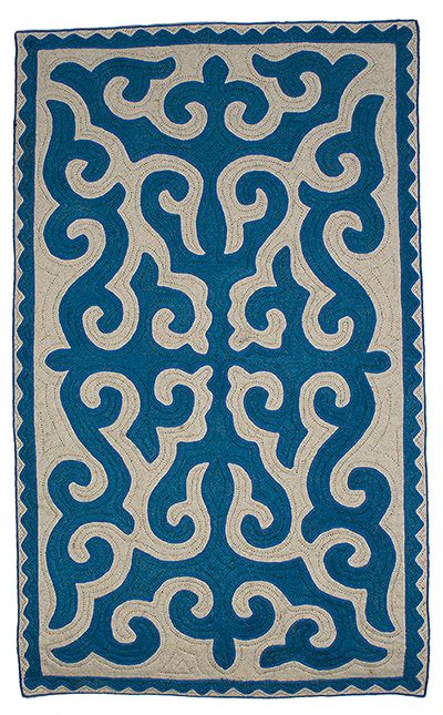 Elegant shyrdak felt rug from Felt combining all-natural, un-dyed, pure white wool felt and a beautiful blue coloured felt with wool braiding in a lighter shade of blue 0.9m x 1.5m feltrugs.co.uk
