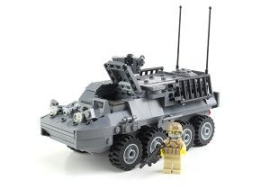 Army Stryker made with 275 Real LEGO® Pieces. This set includes a Removable Roof For Easy Access To The Interior, Seating For Up To 7 Mini-Figures (1 Driver And 6 Passengers), Remote Weapons Station Armored With A .50 Caliber Machine Gun, Smoke Grenade Launchers, 4 Opening Hatches, Mini-Figure Controls For The Driver, 1 Tan Mini-Figure With A Modern Combat Helmet, 1 M4 Assault Rifle