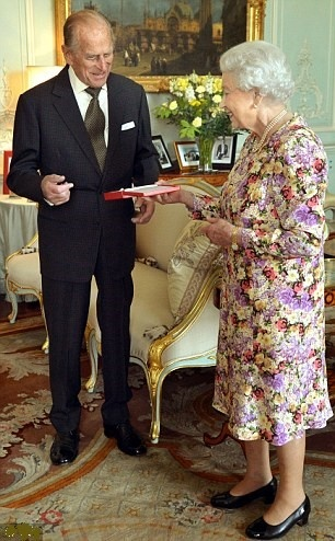 Queen Elizabeth II presents the Duke of Edinburgh with the Order of New Zealand award at Buckingham Palace in central London on 6 June 2013