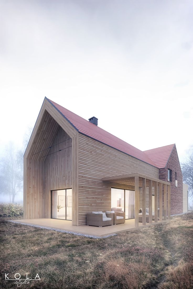 Exterior visualization of a modern barn type house in autumn atmosphere, with cloudy sky, mist and yellowed grass. Architectural design by Majchrzak Pracownia Projektowa. Visuals by Kola Studio.