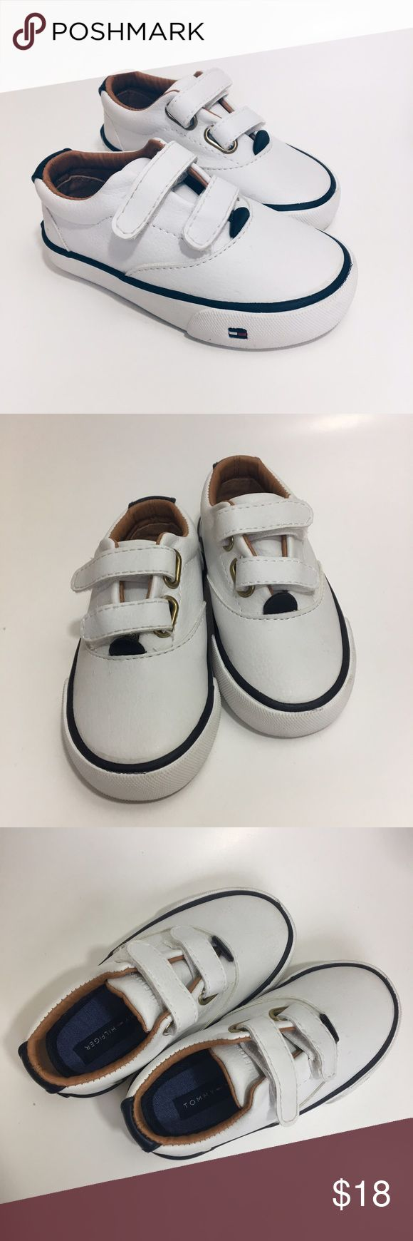 "BOGO FREE ⭐️ Tommy Hilfiger White Velcro Sneakers NWOT White sneakers with navy blue accent & brown inner lining makes these sneakers adorable for many outfits - for boys or girls! Velcro fasteners. Size 6 - 6"" from front to back of bottom sole. Tommy Hilfiger Shoes Sneakers"