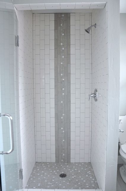 vertical subway tile shower stall with waterfall accent capiz shell tile