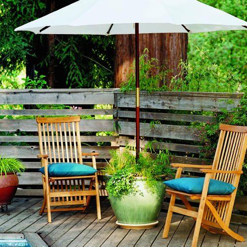 Cute idea-- Use a big flower pot outside as a patio umbrella