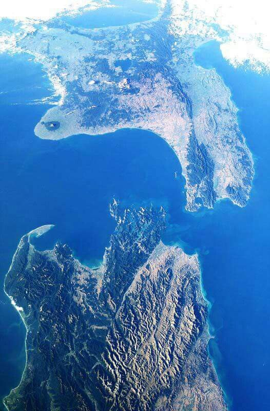 Cook Strait lies between the North & South Islands of New Zealand. It connects the Tasman Sea on the northwest with the South Pacific Ocean on the southeast, & runs next to the capital city, Wellington.