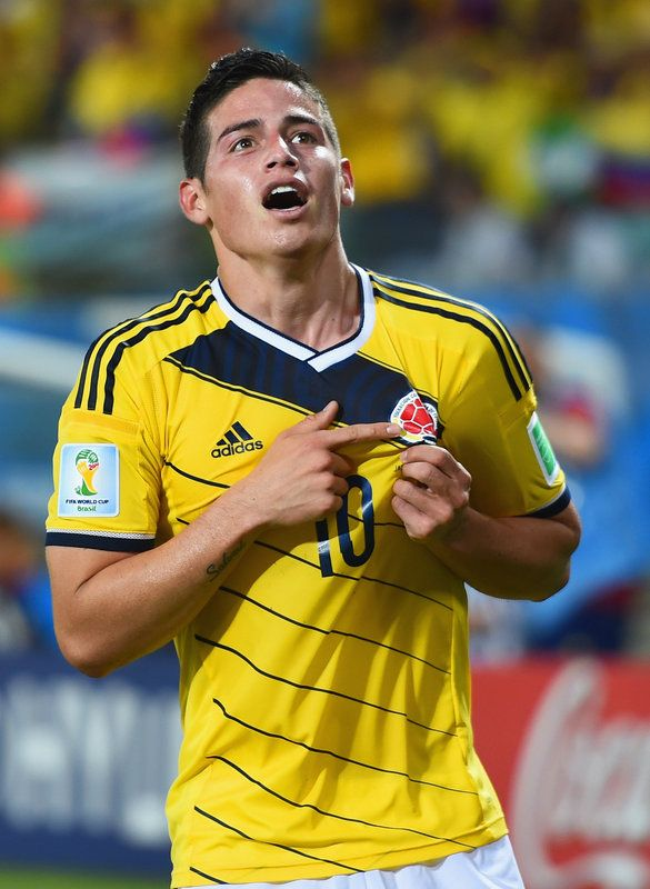 FIFA World Cup 2014 - Colombia 4 Japón 1 (6.24.2014) James Rodriguez of Colombia celebrates scoring his team's fourth goal during the 2014 FIFA World Cup Brazil Group C match between Japan and Colombia at Arena Pantanal on June 24, 2014 in Cuiaba, Brazil. Christopher Lee / Getty Images