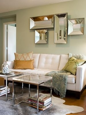 Bleached Cow Hide Rug, and mirrored trays as art…