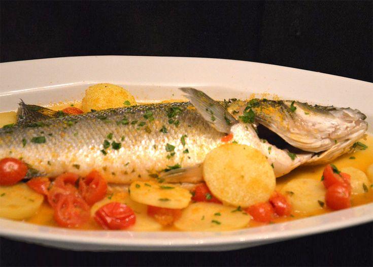 Spigola alla bottarga patate e pomodori | Ricette di Sardegna