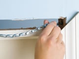 RUNNING WIRES AND CABLES IN WALLS, AROUND DOORWAYS AND BEHIND BASEBOARDS - Learn how to hide wires and cables around doorways, behind baseboards and inside walls.