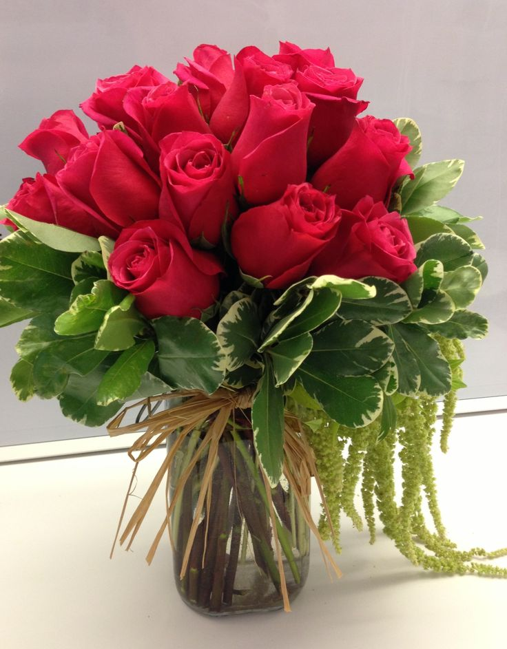 Rose arrangement. Satin ribbon in place of the raffia for a dressier look