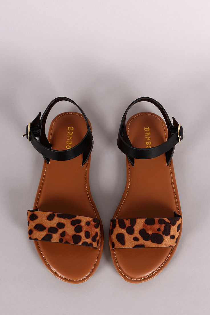 Description This flat sandal features one band leopard print across vamp, and an ankle strap with an adjustable side buckle. Finished with a lightly padded insole. Material: Vegan Leather/Fabric (man-