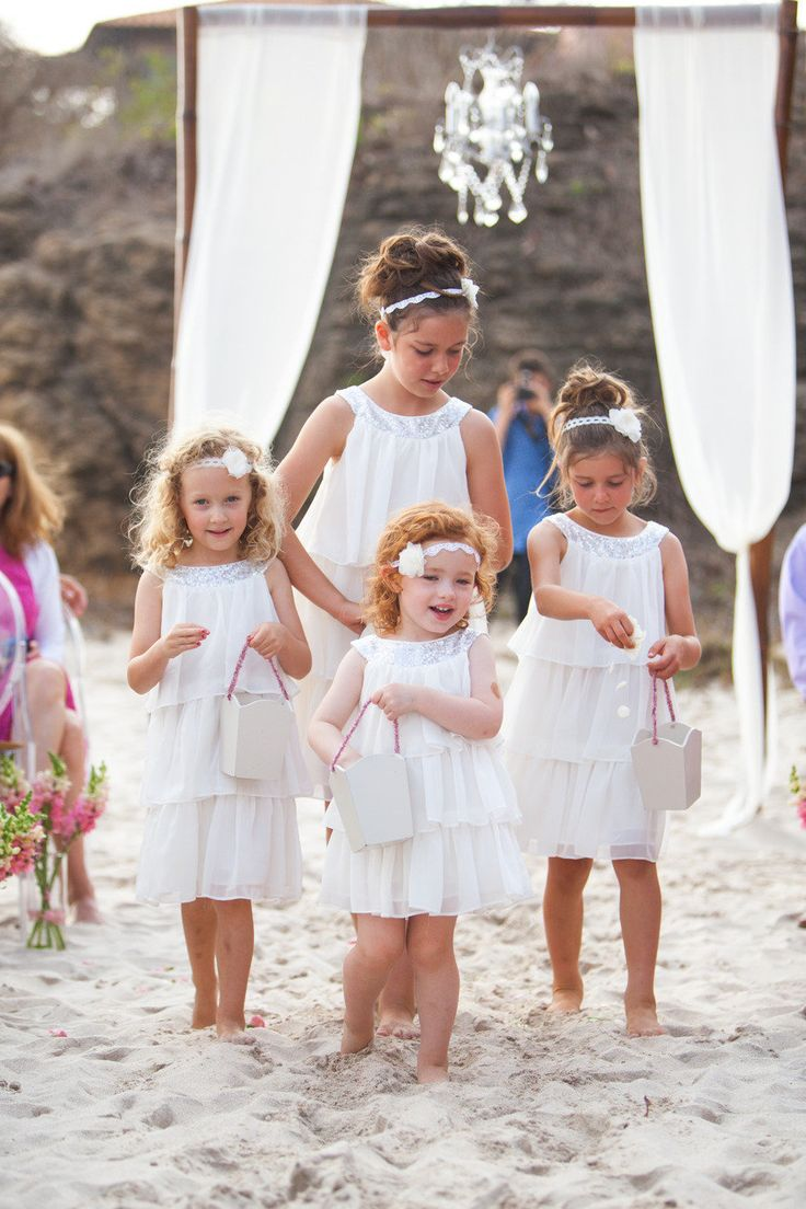 What's better than a flower girl? Four flower girls! So cute! 3 younger nieces, 1 older niece to guide them along