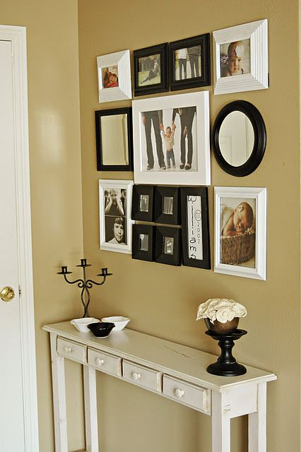 Greet your guests (and your lovely self!) with a little entry gallery of your favorites. A mirror's a nice idea, too.