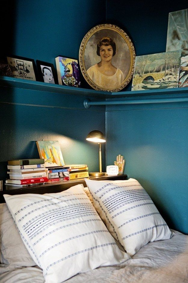 Sandwich a small table behind your bed to show off the pile of books you want to read.