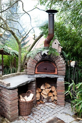 the chimney on this outdoor fireplace might work better than a great big stack of bricks that the neighbours might not like!!