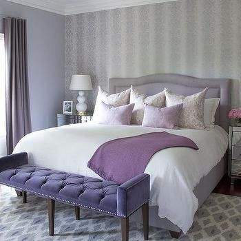 Grey And Purple Bedroom Features An Accent Wall Clad In Ivory And Grey Wallpaper Lined With A Purple Camelback Nailhead Bed Dressed In White Bedding