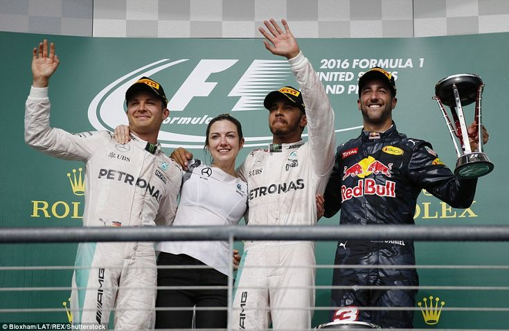 Lewis Hamilton celebrates US GP victory with second placed team-mate Nico Rosberg and Red Bull's Daniel Ricciardo in third