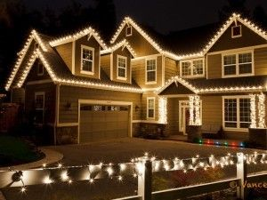 Residential Outdoor Christmas Light Display | C9 Lights decorate the house while the fence is wrapped with mini ...